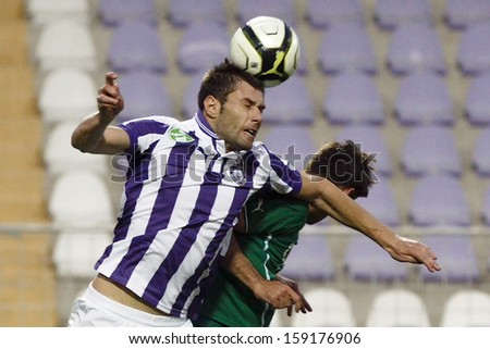 BUDAPEST - OCTOBER 20: Juanan of Ujpest (L) heads the ball during Ujpest vs. Gyori ETO OTP Bank League match at Szusza Stadium on October 20, 2013 in Budapest, Hungary.