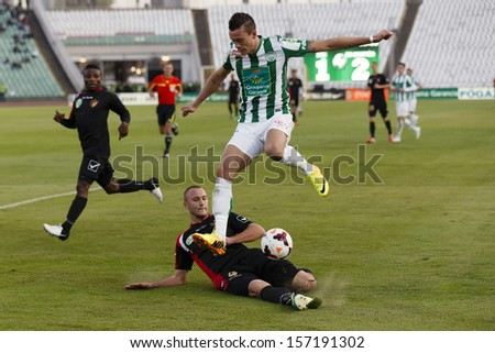 BUDAPEST - OCTOBER 6: Julian Jenner of FTC (R) is tackled by Aleksandar Ignjatovic of Honved during FTC vs. Honved OTP Bank League match at Puskas Stadium on October 6, 2013 in Budapest, Hungary.
