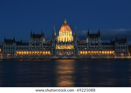 Budapest parliament building on the Danube banks at night - stock photo