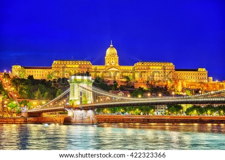 Budapest Royal Castle and Szechenyi Chain Bridge at dusk time from Danube river, Hungary - stock photo