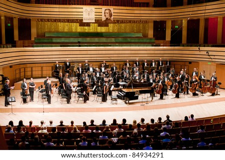 """BUDAPEST - SEPT 18: MR Symphonic Orchestra perform on concert at  """"Palace of Art"""" Budapest Sept 18, 2011 in Budapest, Hungary - stock photo"""