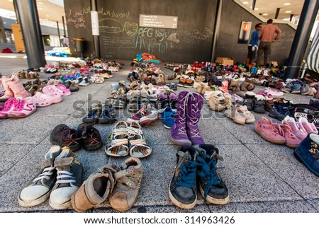 BUDAPEST - SEPTEMBER 7: child shoes for war refugees at Keleti Railway Station on 7 September 2015 in Budapest, Hungary. Refugees are arriving constantly to Hungary on the way to Germany.