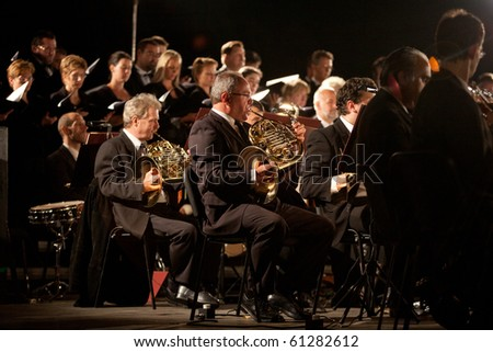 BUDAPEST - SEPTEMBER 14: Members of the Filharmonia Zenekar perform on stage at Karolyi Palace, Conductor: Kalman Strausz on September 14, 2010 in Budapest, Hungary.