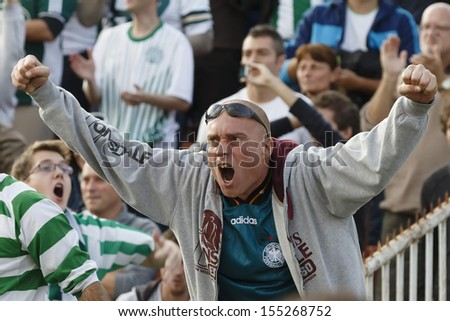 BUDAPEST - SEPTEMBER 22: Supporter of FTC celebrates his team's score during Ferencvaros vs. Ujpest OTP Bank League football match at Puskas Stadium on September 22, 2013 in Budapest, Hungary.  - stock photo