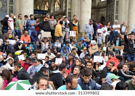 BUDAPEST - SEPTEMBER 5, 2015 : War refugees at the Keleti Railway Station on 5 September 2015 in Budapest, Hungary. Refugees are arriving constantly to Hungary on the way to Germany. - stock photo