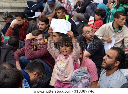 BUDAPEST - SEPTEMBER 5 : War refugees at the Keleti Railway Station on 5 September 2015 in Budapest, Hungary. Refugees are arriving constantly to Hungary on the way to Germany. - stock photo