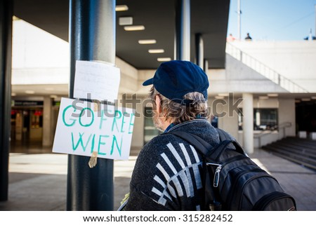 BUDAPEST - SEPTEMBER 7: war refugees reading go Wien text at Keleti Railway Station on 7 September 2015 in Budapest, Hungary. Refugees are arriving constantly to Hungary on the way to Germany.
