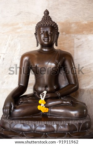 Buddha, a symbol of Buddhism. The pattern on the temple. - stock photo