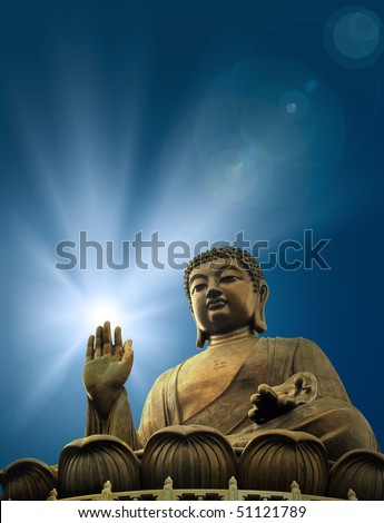 Buddha and a light symbolic of enlightenment - stock photo