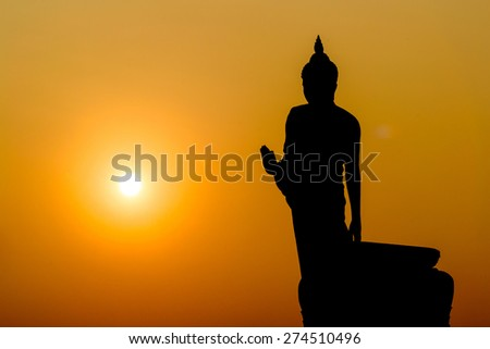 Buddha at sunset. When the evening sun is bright red. Lord Black is a sleek backlit. Public Art