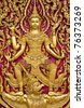 Buddha carved gold paint on temple door - stock photo
