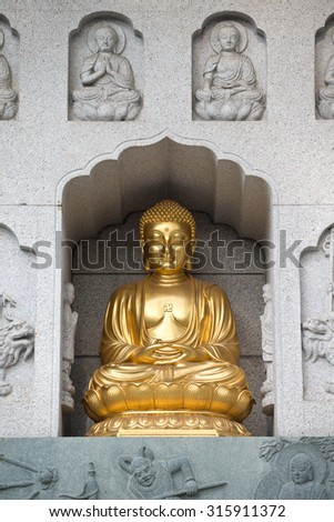 Buddha Detail of a Buddhist Temple in Singapore. - stock photo
