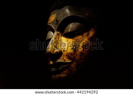 Buddha Face Isolated on Black Background - stock photo