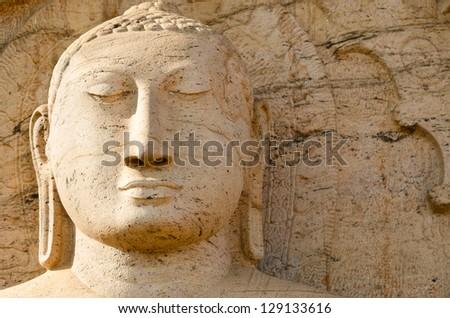 Buddha face on yellow stone background, Polonnaruwa, Sri Lanka - stock photo