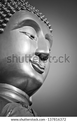 Buddha face, processed with black and white style. - stock photo