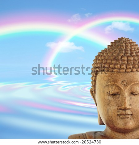 Buddha face with blue sky and two rainbows with reflection over rippled water to the rear.