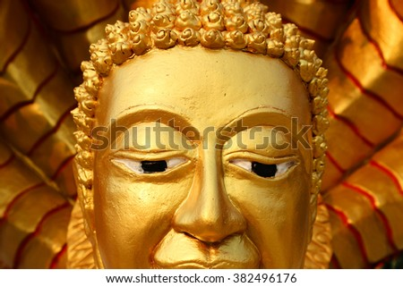 Buddha gold statue close-up