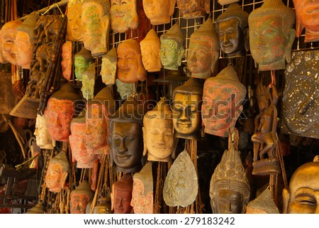 Buddha head masks and carvings,  Old Market, Siem Reap,  Cambodia - stock photo