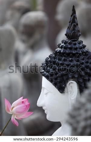 buddha image with lotus flower - stock photo