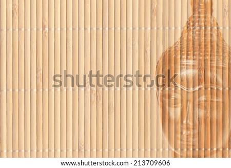 Buddha on bamboo mat horizontally - stock photo