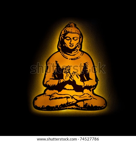 Buddha on the wall with light - stock photo
