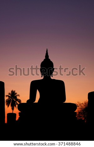 Buddha silhouette at sunset with large copyspace