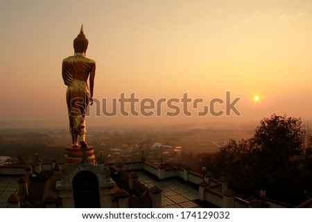 Buddha standing on a mountain Nan Province, Thailand