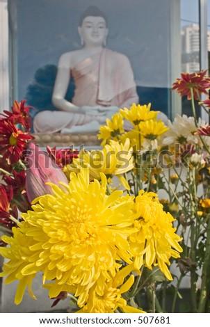 Buddha statue and chrysanthemum  flower - stock photo