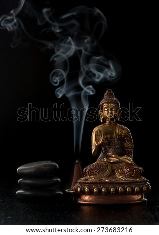 Buddha statue and stones zen. Spa and meditation concept - stock photo