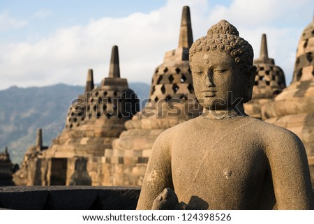 Buddha statue and stupas in Borobudur, or Barabudur, temple Jogjakarta, Java, Indonesia. It is a 9th-century Mahayana temple and the biggest  Buddhist Temple in Indonesia. - stock photo
