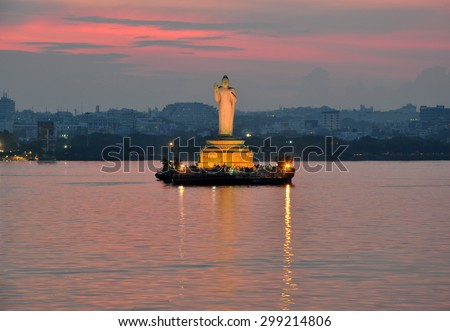 Buddha statue at dusk in Hussain Sagar in Hyderabad, India. - stock photo