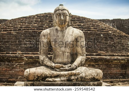 Buddha statue close up in Vatadage, ancient city of Polonnaruwa, Sri Lanka. Vatadage is an ancient monument and it was built for the protection of stupa. - stock photo