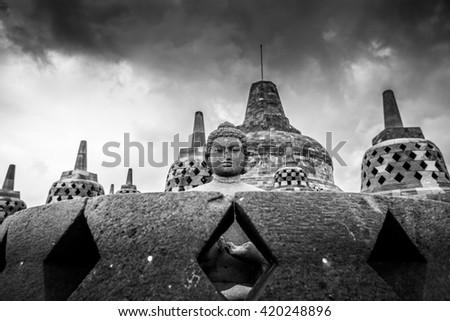 Buddha Statue head of Borobudur Temple on Java Island - stock photo