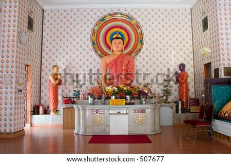 Buddha statue in a temple. - stock photo