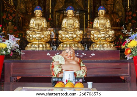 Buddha Statue in Chinese temple - stock photo
