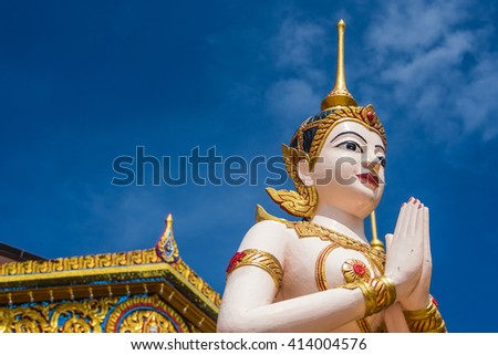 Buddha statue in front of temple usefor input text in fram picture. - stock photo