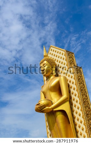 Buddha statue in Phitsanulok province and the blue sky in Thailand - stock photo