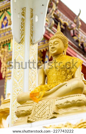 Buddha statue in temple at Rayong, Thailand - stock photo