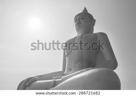 Buddha statue in Thailand with black and white filter - stock photo