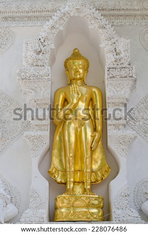 buddha statue in the arch entrance of Wat San Pa Yang Luang, Lamphun, Thailand - stock photo