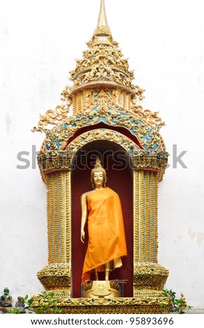 Buddha statue in the golden pagoda of Thai temple. - stock photo