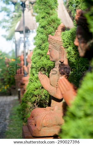 Buddha statue in the tree line. - stock photo