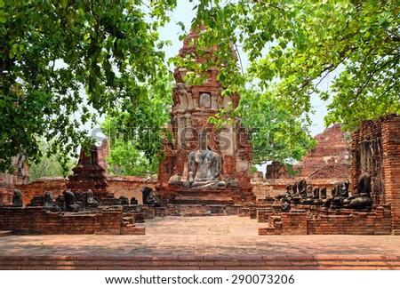 Buddha statue in Wat Mahathat. Ayutthaya historical park, public temple, Thailand - stock photo