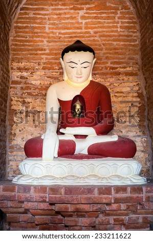 Buddha statue inside Seinnyet Ama Pagoda ruins. Ancient architecture of old Buddhist Temples at Bagan Kingdom, Myanmar (Burma) - stock photo