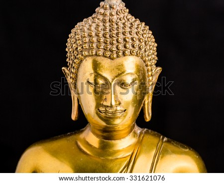Buddha statue on black background,statue in Buddhist Thailand ,  are public  domain  or treasure of Buddhism ,no restrict in copy or use . This photo  taken   these  conditions