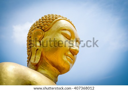 Buddha statue on blue sky - stock photo