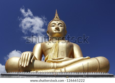Buddha statue with blue sky in the background, Thailand