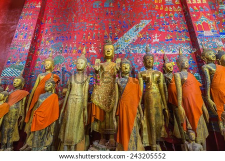 Buddha statues in Wat Xieng Thong in Luang Prabang , Laos ,South East Asia - stock photo