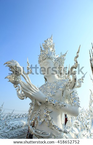 Buddha statues Wat Rong Khun / Temple is a contemporary buddhist beautiful and the artistic value place in Chiang Rai, Thailand. It was designed by Chalermchai Kositpipat. Construction began in 1997. - stock photo