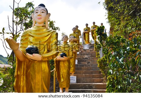 Buddha statues  were walking alms - stock photo
